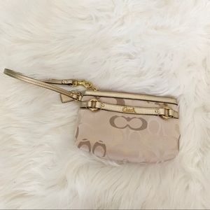Coach tan and gold clutch wristlet.
